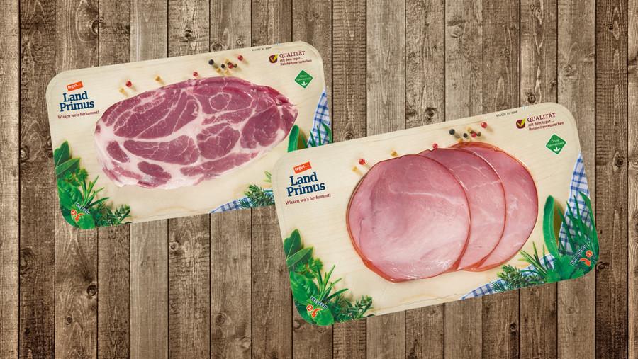 Fleisch- und Wurstpackung auf Holz