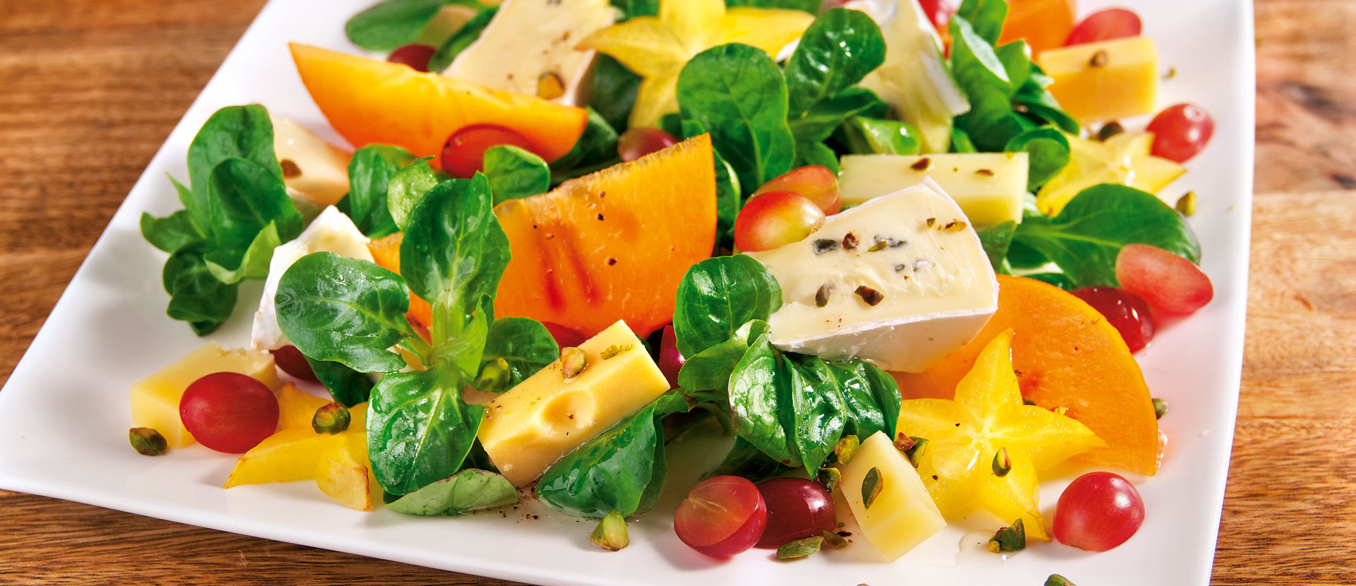 Käsesalat mit exotischen Früchten