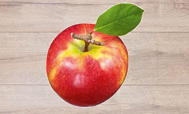 roter Apfel auf Holzhintergrund