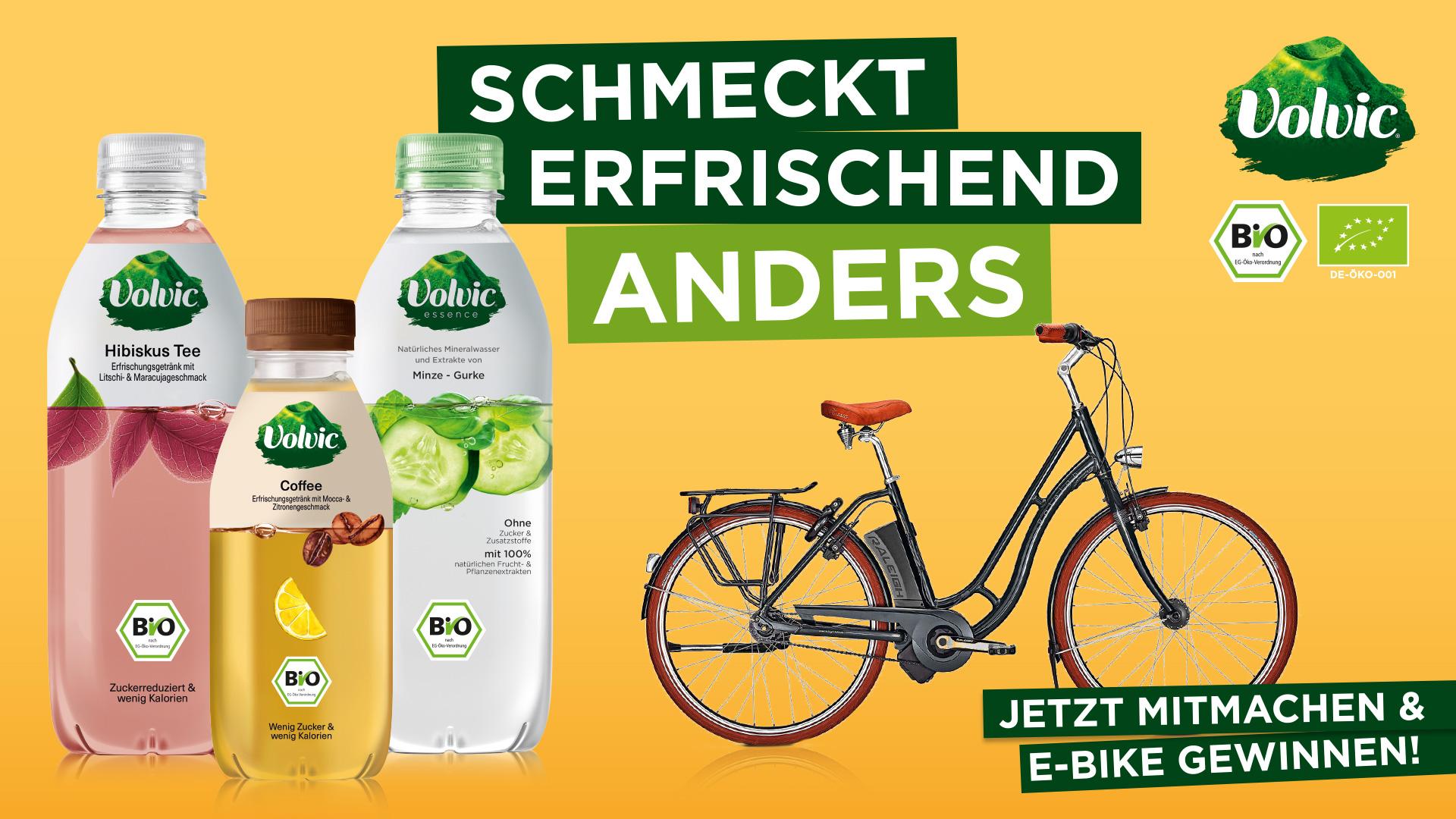 Gewinnspielbanner Volvic mit E-Bike und drei Volvic Getränken in den Sorten Hibiskus Tee, Coffee, Minze-Gurke