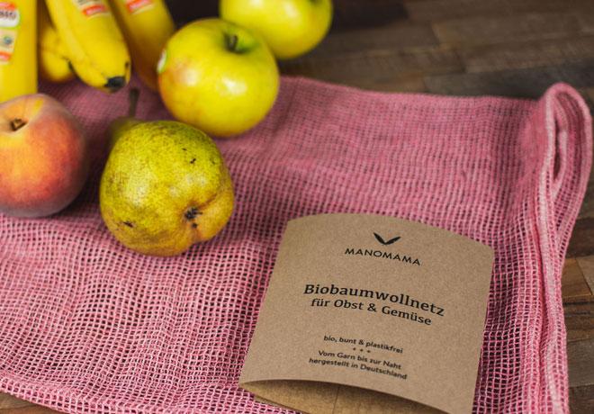 Bio-Baumwollnetz mit Bananen und Äpfeln