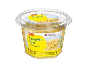 Darstellung von Kartoffelsalat mit Essig und Öl