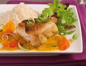 Hähnchen mit Persimonen und Reis